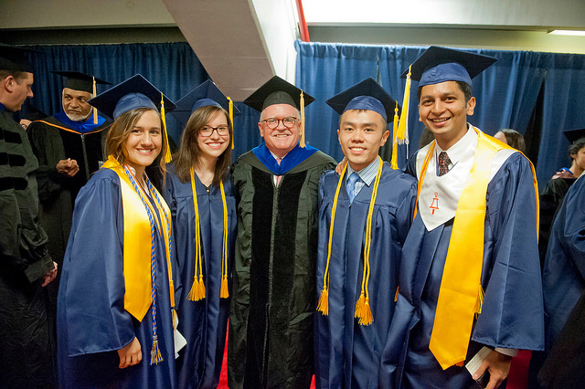 CME's Dr. Christopher Burke, who spoke at graduation, poses with the new 2014 Graduates